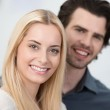 Beautiful smiling blond woman with man — Stock Photo