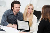 Broker or adviser with a young couple — Stock Photo