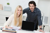 Young businessman and woman in the office — Stock Photo