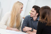 Happy couple in an interview — Stock Photo