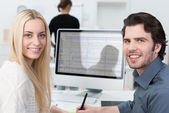 Two friendly young business partners — Stock Photo