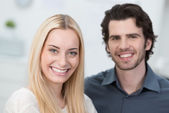 Smiling attractive young couple — Stock Photo