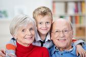 Proud happy grandparents and grandson — Stock Photo