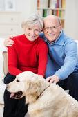 Couple with their golden retriever — Stock Photo