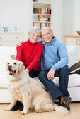 Affectionate senior couple with their dog — Stock Photo