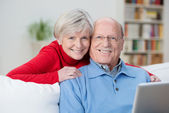 Friendly senior couple with happy contented smiles — Stock Photo