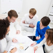 Group of young business partners in a meeting — Stock Photo