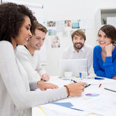 Happy business team sitting in a meeting — Stock Photo