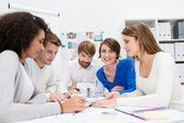 Dedicated young business team in a meeting — Foto de Stock