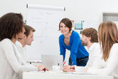 Businesswoman giving a presentation to her team — Stock Photo