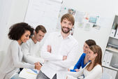Confident smiling young male team leader — Stock Photo
