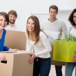 Laughing group of young friends moving house — Stock Photo #40766931