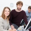 Happy business man and woman working together — Stock Photo