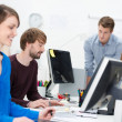 Young businesspeople working in a busy office — Stock Photo #40767691