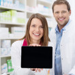 Happy female pharmacist doing a promotion — Stock Photo