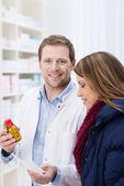Pharmacist and patient discussing her medication — Stock Photo