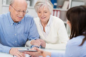 Elderly couple receiving financial advice — Stock Photo