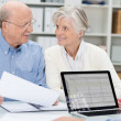 Elderly couple in a meeting with an adviser — Stock Photo #41302985