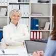 Senior woman attending a meeting in an office — Stock Photo #41303047