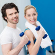 Couple working out with dumbbells — Stock Photo
