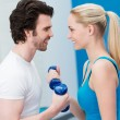 Smiling couple working out together in the gym — Stock Photo #41309107