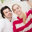 Happy stylish couple taking a self portrait — Stock Photo #41309287