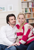 Loving young couple relaxing at home — Stok fotoğraf