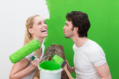 Woman with a paint roller with husband — Stock Photo