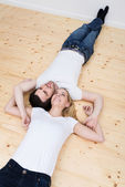 Young couple relax on their backs — Stock Photo