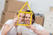 Young couple dreaming of their new home — Foto de Stock