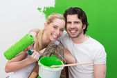 Couple painting their house green — Stock Photo