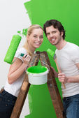 Couple redecorating their new house — Stock Photo