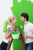 Couple painting their new house — Stock Photo