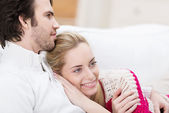 Dreamy woman relaxing on her husbands chest — Stock Photo