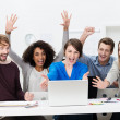 Excited successful business team cheering — Stock Photo #42483833