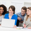 Happy group of friends laughing and waving — Stock Photo #42486819