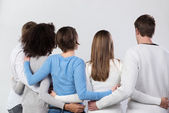 Rear view of a group of friends arm in arm — Stock Photo