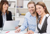 Happy confident young couple in a meeting — Stock Photo