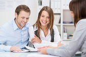 Investment adviser giving a presentation to couple — Stock Photo