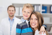 Young mother and son in a doctors surgery — Stock Photo
