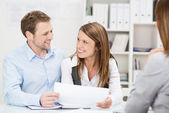 Young couple discussing an investment presentation — Stock Photo