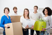 Group of multiethnic friends helping to move house — Stock Photo