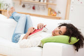 Woman fall asleep on sofa — Stock Photo