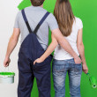 Couple admiring the newly painted wall — Stock Photo