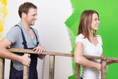 Couple doing home redecorating — Stock Photo
