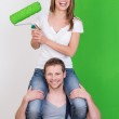Playful young couple painting their home — Stock Photo #44139167