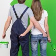Young couple admiring the newly painted wall — Stock Photo #44139433
