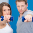 Young couple working out together — Stock Photo #44139573