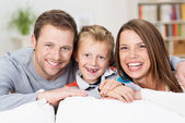 Laughing happy young family — Stock Photo