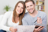 Happy young couple looking at a diagram — Stock Photo